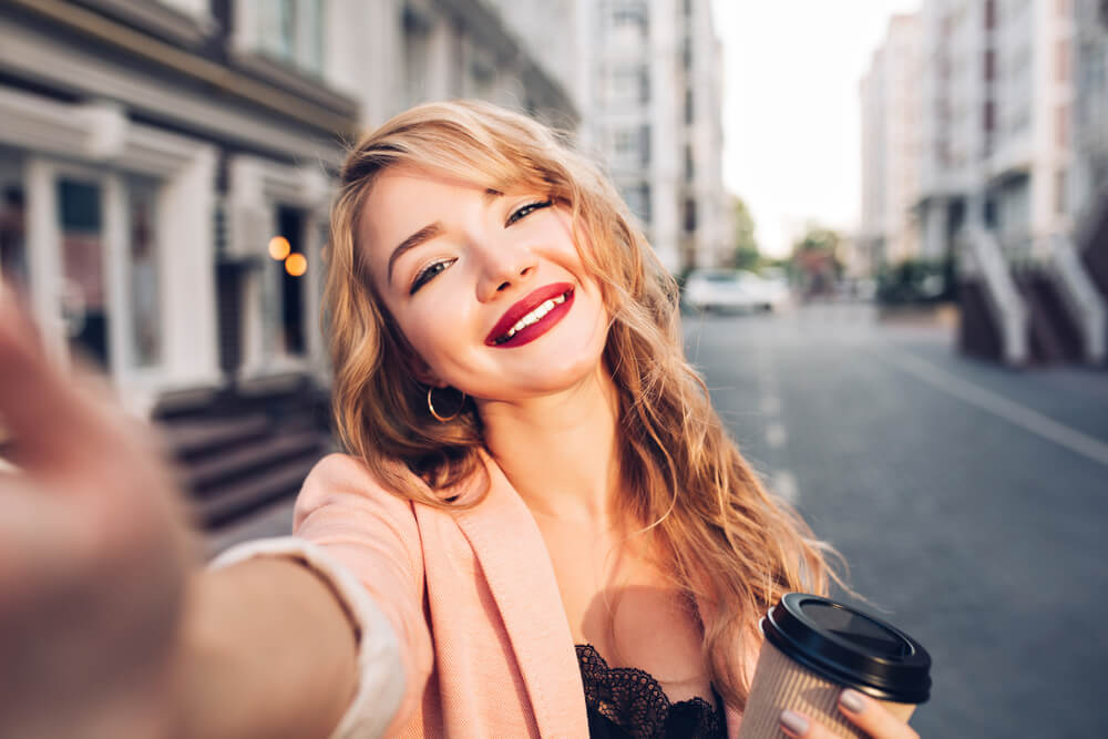 Woman taking a selfie in the street