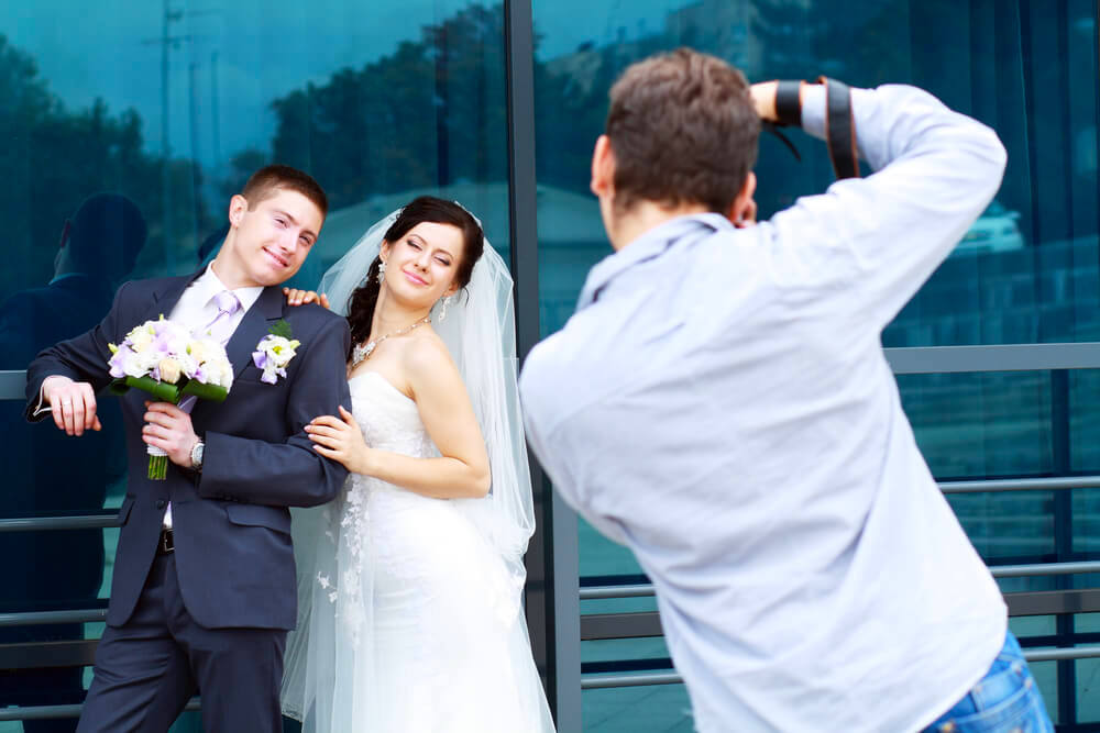 wedding photographer taking picture of couple