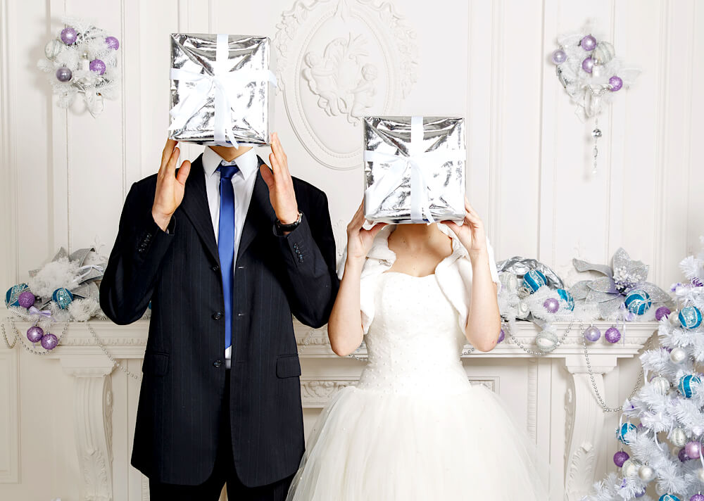 Wedding couple with silver gifts
