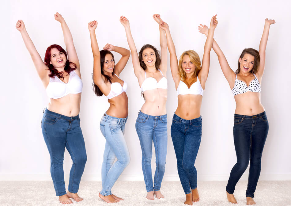 happy diverse women in jeans
