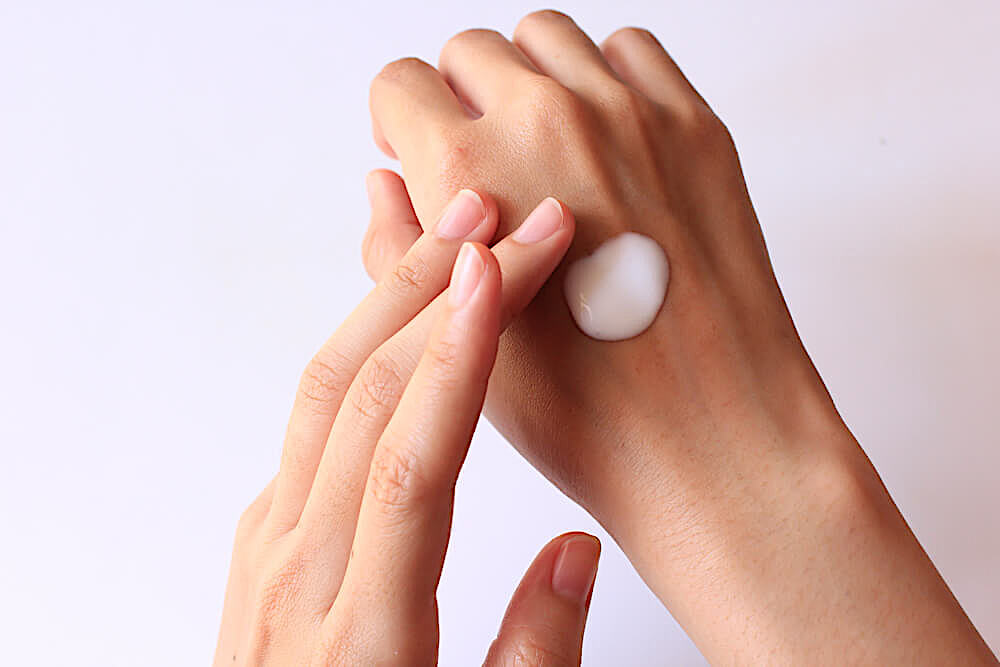 Applying lotion to the back of hand
