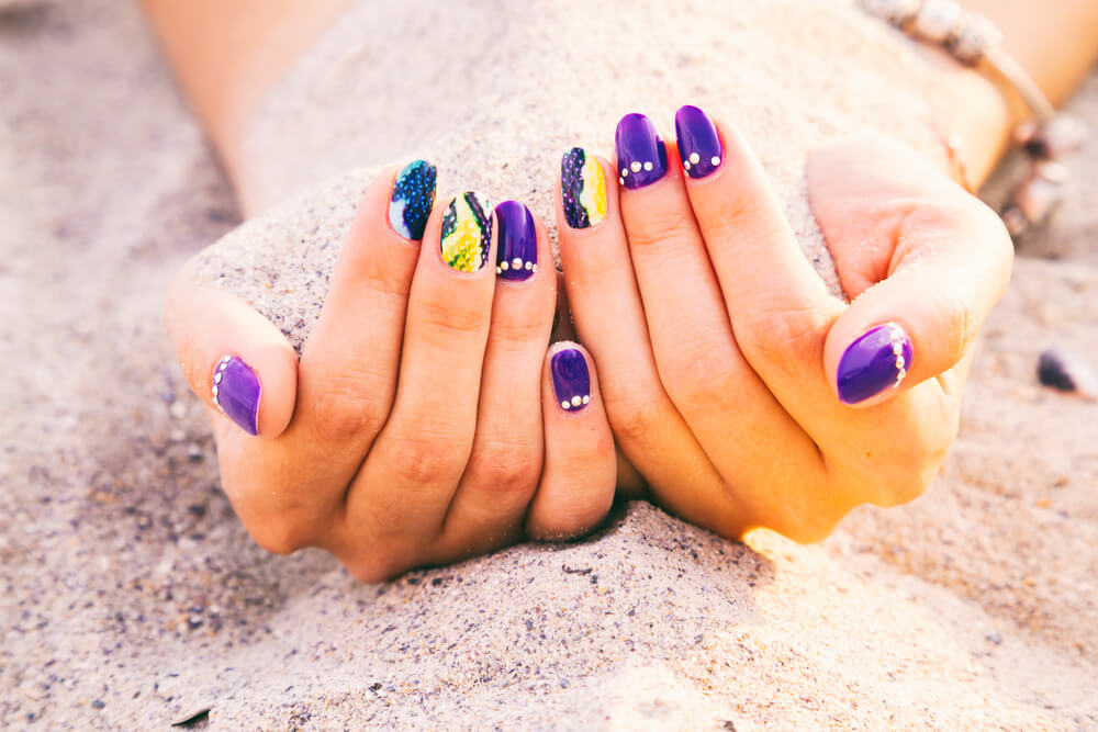 Purple and blue nail design with snakeskin effect