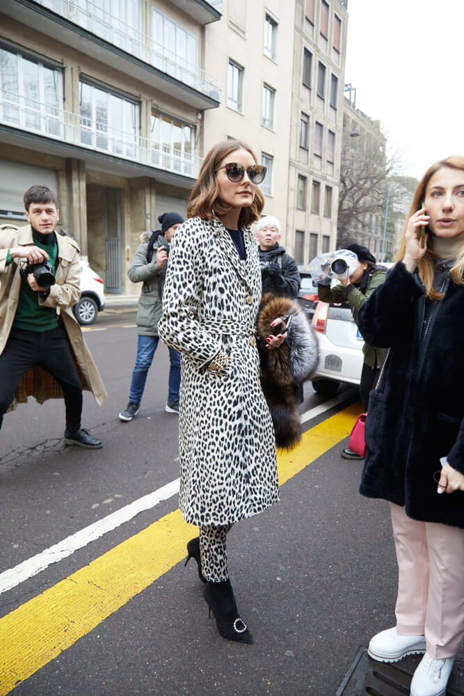 MILAN - FEBRUARY 22: Olivia Palermo with black and white spotted coat and sunglasses before Max Mara fashion show, Milan Fashion Week street style on February 22, 2018 in Milan.