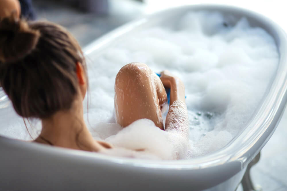 Woman enjoying a foamy bubble bath
