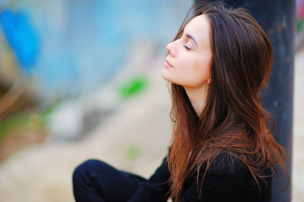 Young woman breathing and relaxing