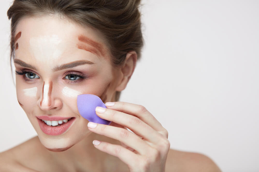 Blending in makeup with a blending sponge