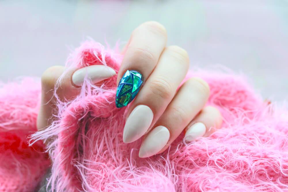 Pale nude nail art with rhinestone