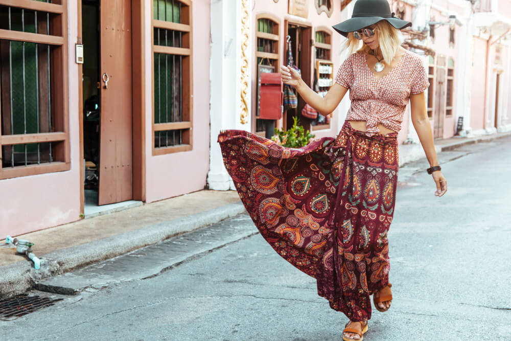 Woman in long maxi skirt walking down a European street
