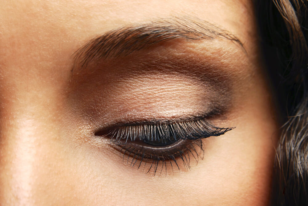 Closeup of eye with black eyeliner and soft brown eyeshadow