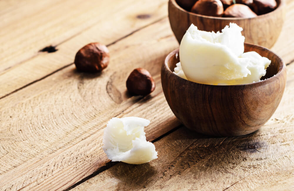 Shea nuts and butter in a bowl