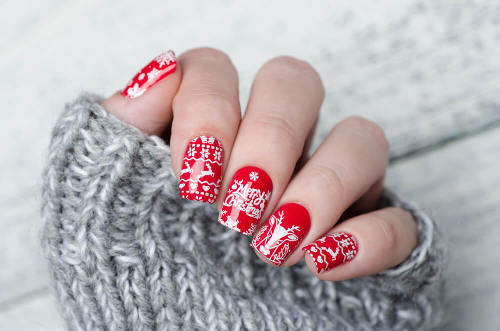 Red nails with white Christmas nail art