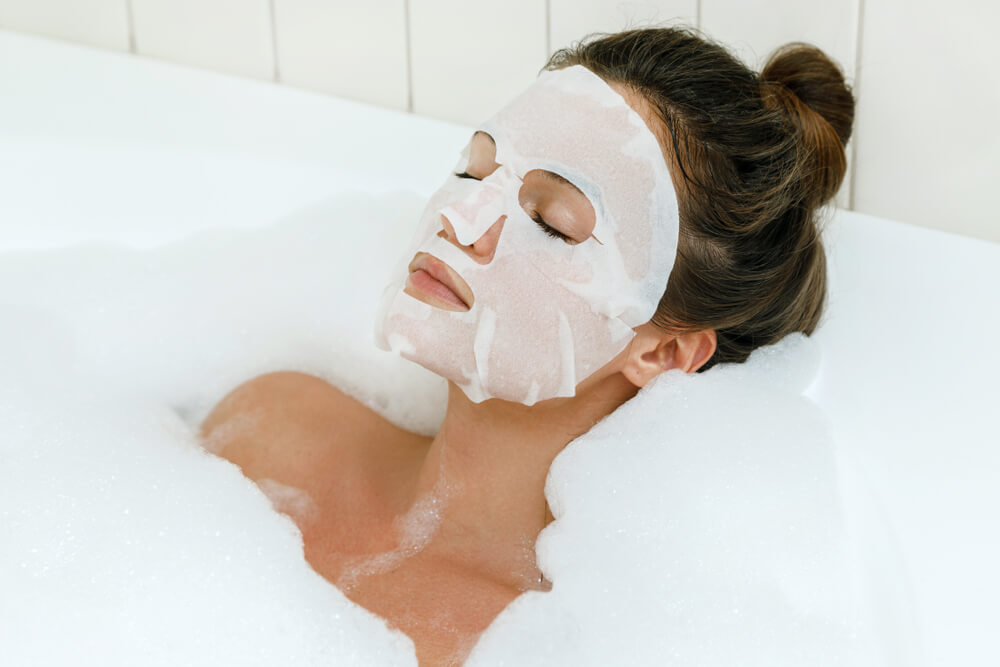 Woman in bath with face mask
