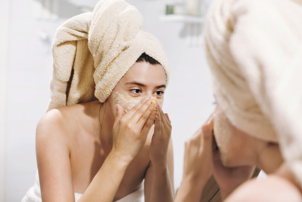 Woman using face scrub