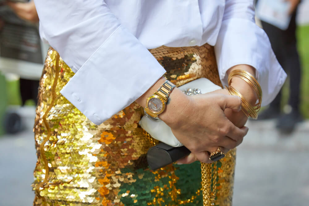 Close-up of woman wearing sequin skirt holding bag