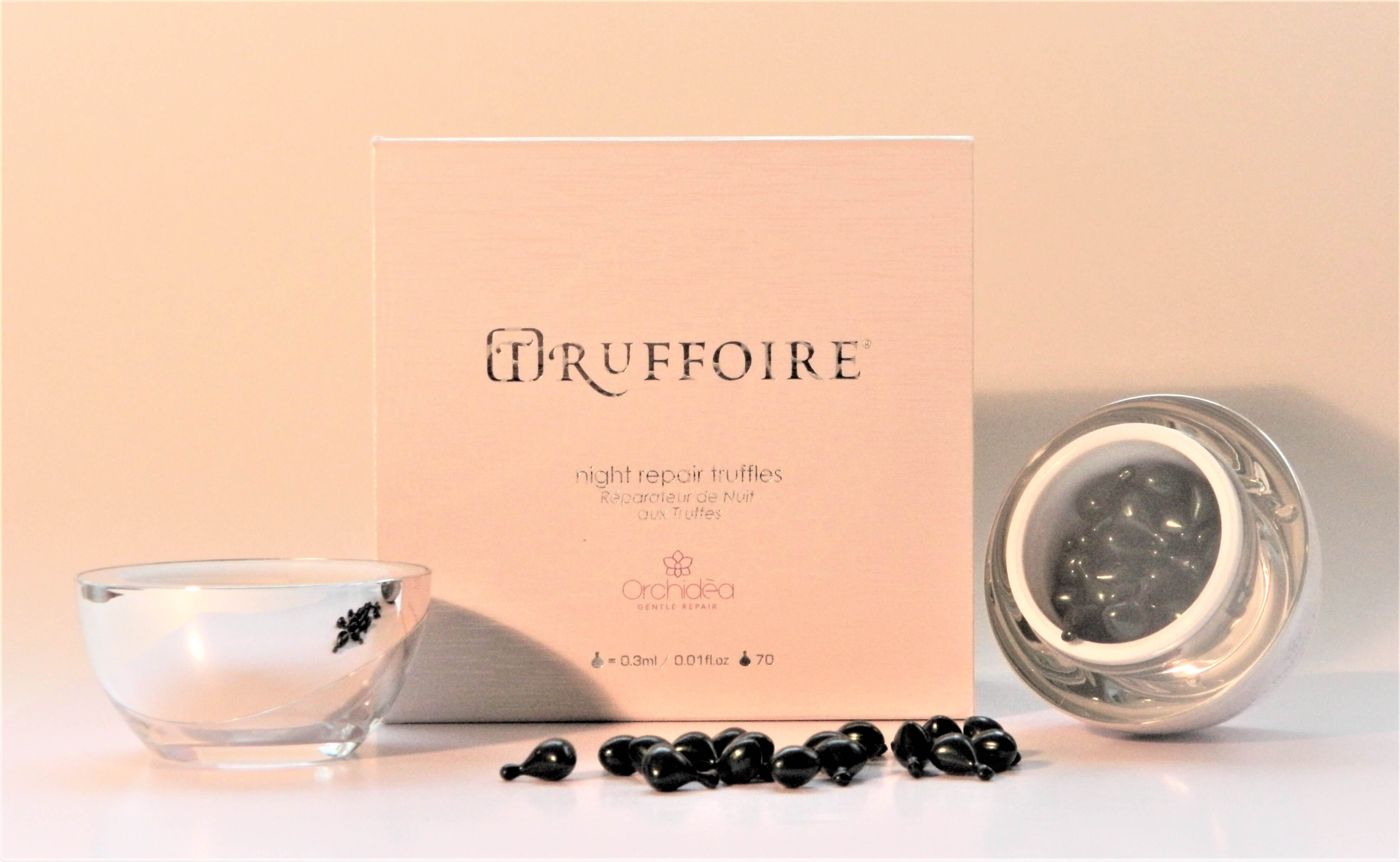Truffoire skincare capsules in front of box