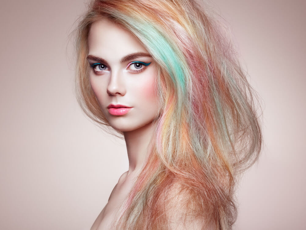 Woman with rainbow colored hair
