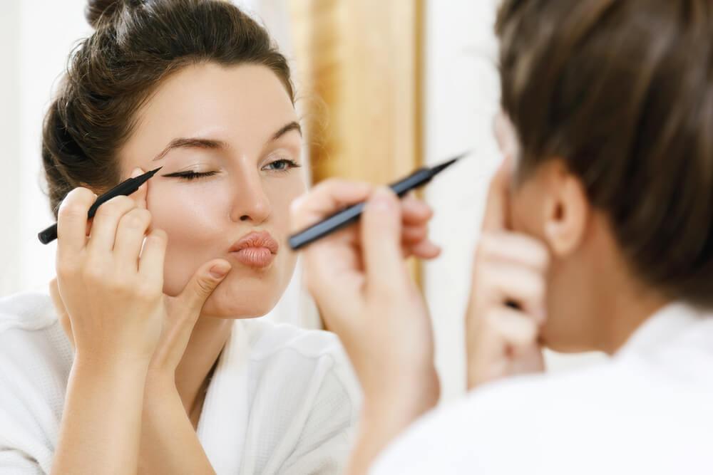 Woman making eyeliner mistake