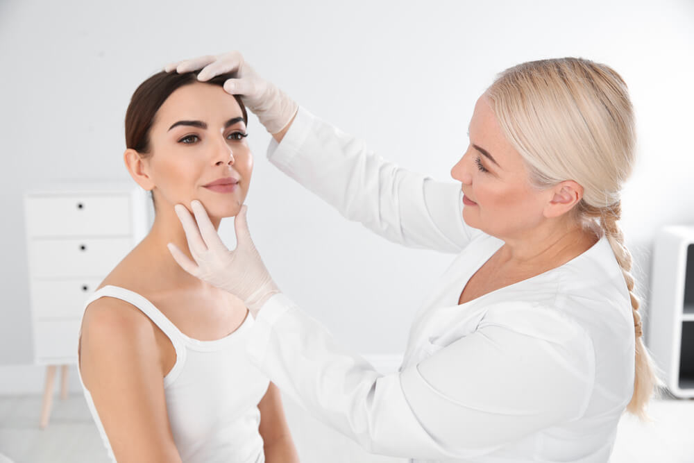 Woman at dermatologist consultation