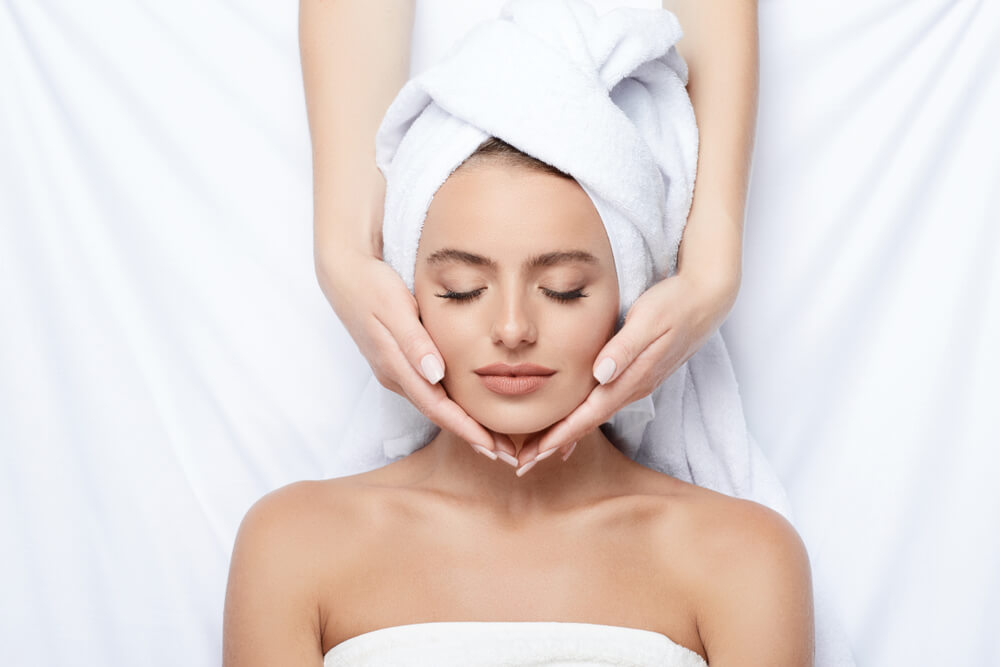 Woman having head massage in spa