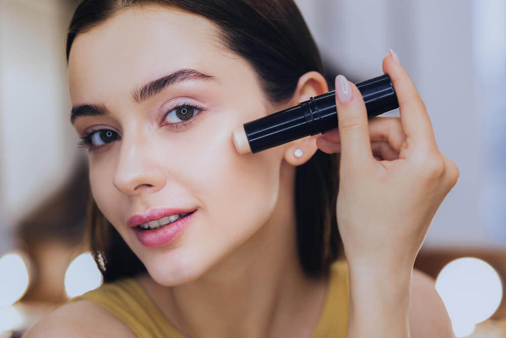 Woman applying foundation