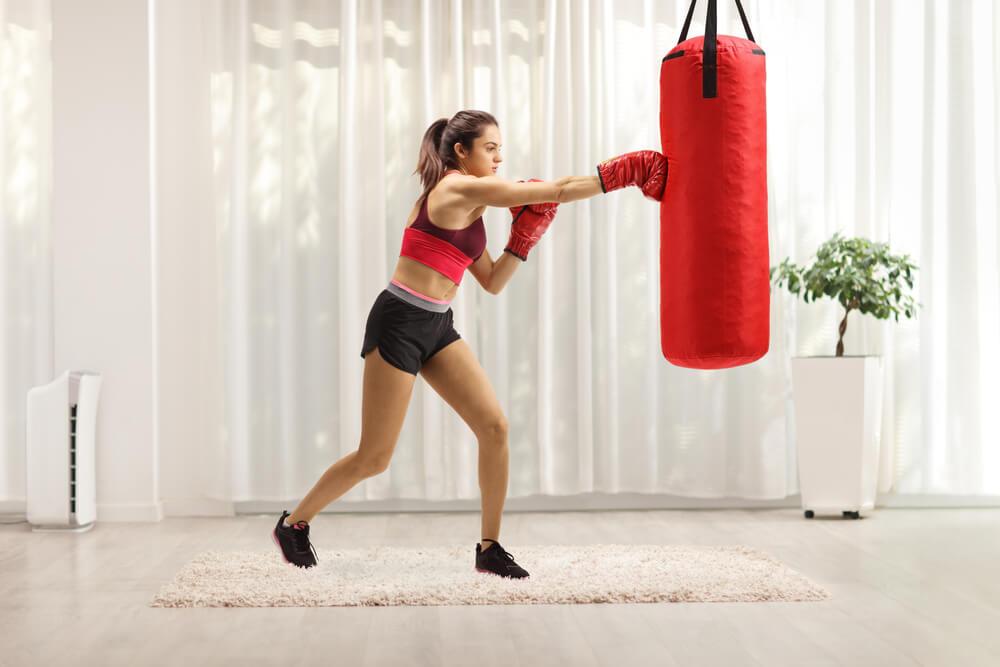Woman using punching bag